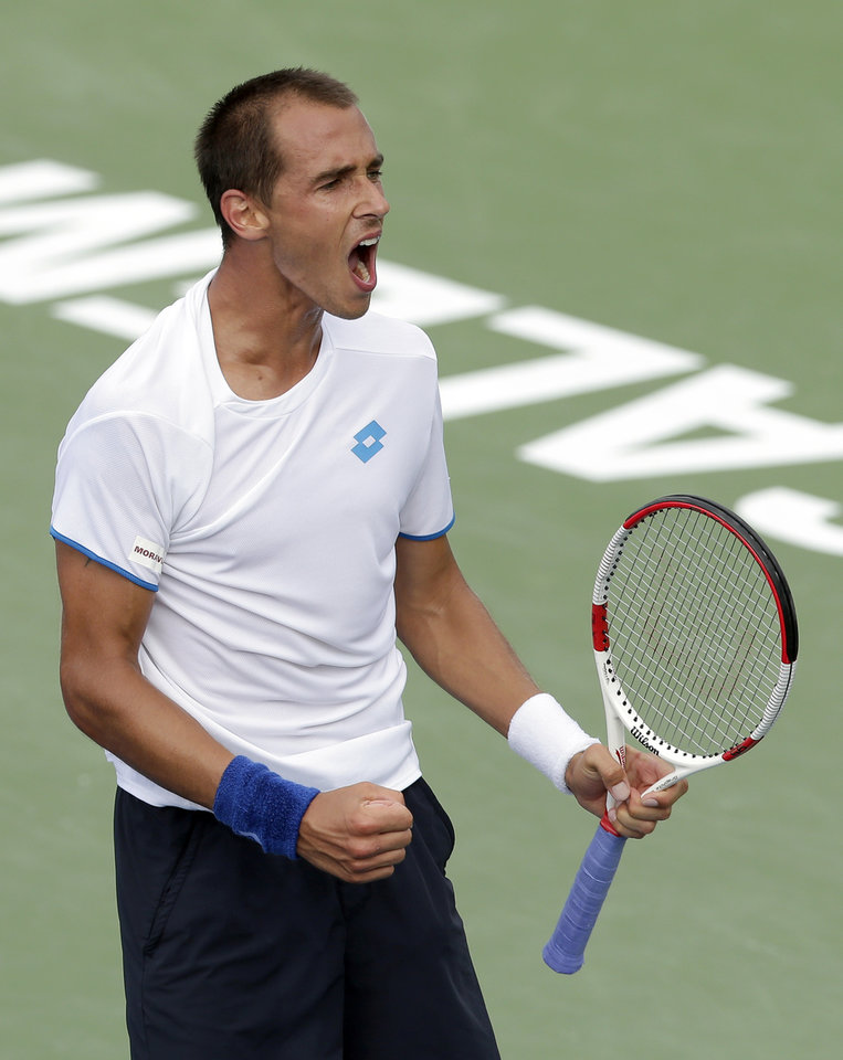Photo - Lukas Rosol, of Czech Republic, reacts after defeating Yen-Hsun Lu, of Taiwan, in their semi-final match at the Winston-Salem Open tennis tournament in Winston-Salem, N.C., Friday, Aug. 22, 2014. Rosol defeated Lu 7-5, 4-6, 6-4. (AP Photo/Chuck Burton)