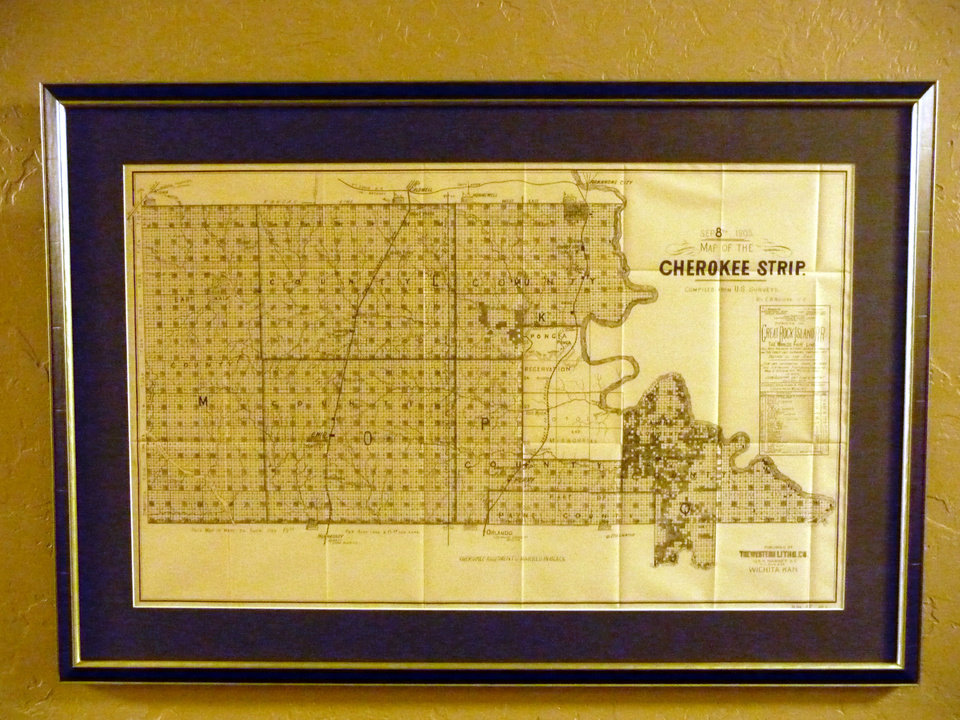 Historical Map Collector Andy Lester has this September 1893 survey map of the Cherokee Strip on display at his law firm in Edmond. It outlines plots of land available before one of the Oklahoma land-runs. PHOTOs BY KEVAN GOFF-PARKER, For The Oklahoman