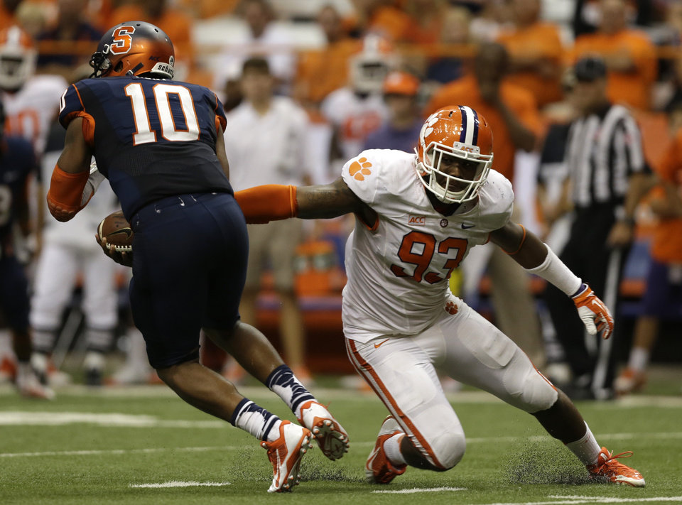 Clemson defensive end Corey Crawford (93) pressures Syracuse quarterback Terrell Hunt (10) during the second half of an NCAA college football game on Saturday, Oct. 5, 2013, in Syracuse, N.Y. Clemson won, 49-14. (AP Photo/Mike Groll)