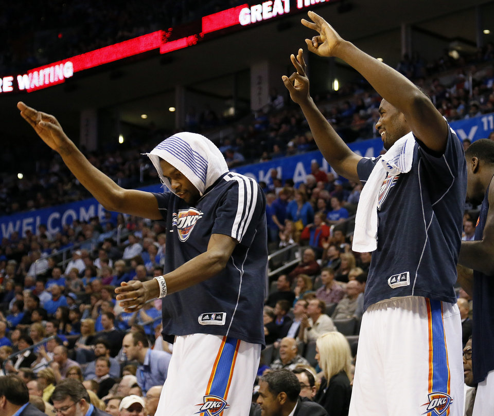 Oklahoma City\'s Kevin Durant (35) and Serge Ibaka (9) celebrate from the bench after a 3-point shot in the fourth quarter during an NBA basketball game between the Oklahoma City Thunder and the Dallas Mavericks at Chesapeake Energy Arena in Oklahoma City, Monday, Feb. 4, 2013. The Thunder won. 112-91. Photo by Nate Billings, The Oklahoman