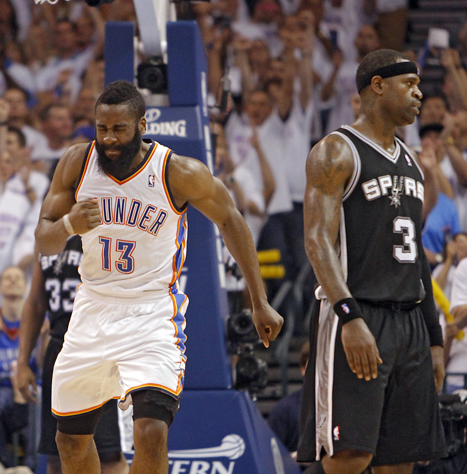 Photo - Oklahoma City's James Harden reacts in front of San Antonio's Stephen Jackson (3) after making a shot during Game 6 of the Western Conference Finals between the Oklahoma City Thunder and the San Antonio Spurs in the NBA playoffs at the Chesapeake Energy Arena in Oklahoma City, Wednesday, June 6, 2012. Photo by Chris Landsberger, The Oklahoman