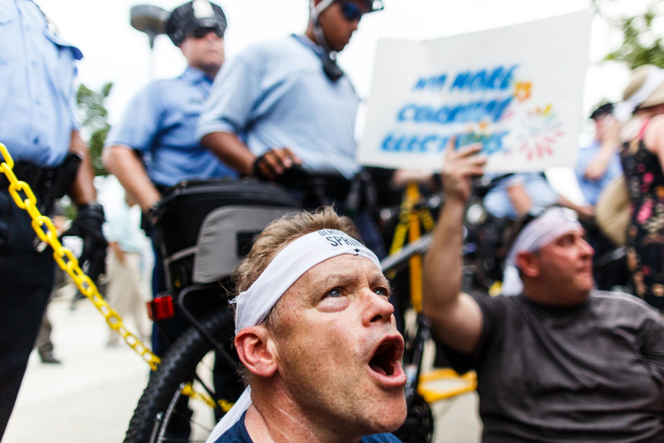 Photo - Kevin Muenster and protestors block off the entrance to the closest subway station to the Wells Fargo center Monday, July 25, 2016, in Philadelphia, during the first day of the Democratic National Convention. (James Robinson/PennLive.com via AP)