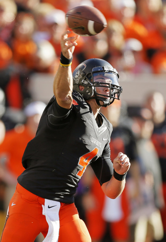 Oklahoma State\'s J.W. Walsh (4) passes during a college football game between the Oklahoma State University Cowboys (OSU) and the Kansas State University Wildcats (KSU) at Boone Pickens Stadium in Stillwater, Okla., Saturday, Oct. 5, 2013. OSU won, 33-29. Photo by Nate Billings, The Oklahoman