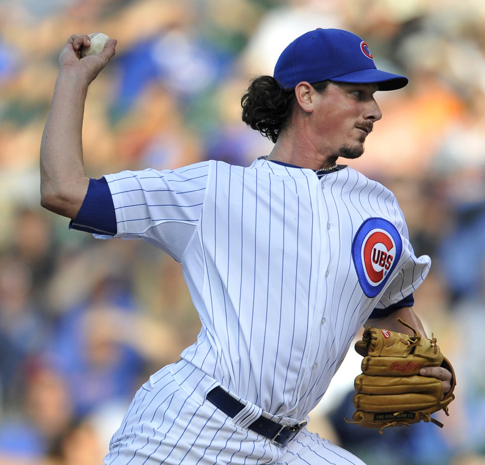 Photo - Chicago Cubs starter Jeff Samardzija delivers a pitch during the first inning of a baseball game against the Washington Nationals in Chicago, Saturday, June 28, 2014. (AP Photo/Paul Beaty)