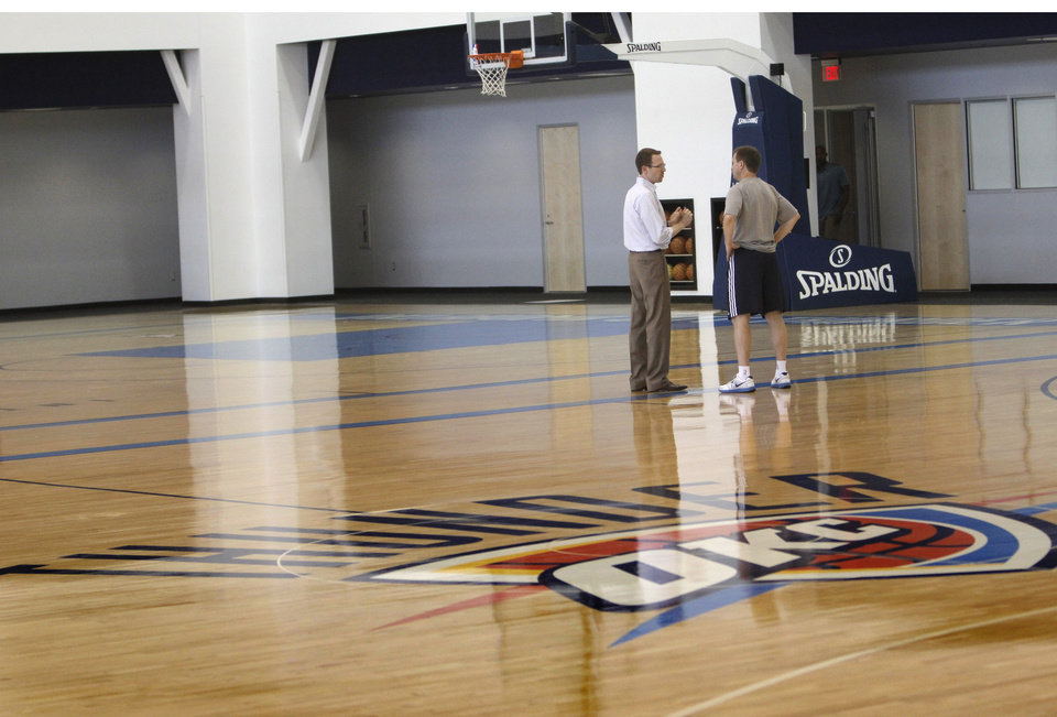 Photo - General manager Sam Presti, left, talks with Scott Brooks after the Thunder practice Sunday, June 10, 2012. Photo by Doug Hoke, The Oklahoman