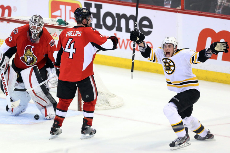 Boston Bruins' Dennis Seidenberg, left, celebrates his winning goal against the Ottawa Senators with Patrice Bergeron (37), Tyler Sequin (19) and Zdeno Chara (33) during the third period of their NHL hockey game, Thursday, March 21, 2013, in Ottawa, Ontario. The Bruins won 2-1. (AP Photo/The Canadian Press, Fred Chartrand)