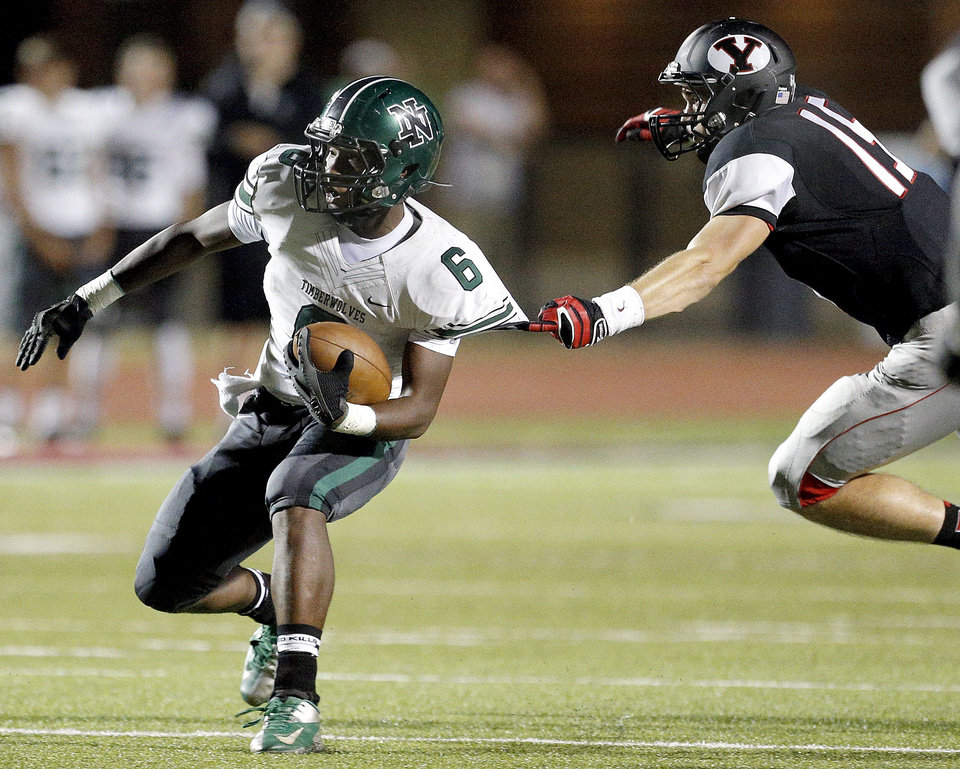 Norman North's Z'Quan Hogan tries to get by Yukon's Tucker Doyle during a high school football game between Yukon and Norman North in Yukon, Okla.,   Friday, Oct. 4, 2013. Photo by Sarah Phipps, The Oklahoman