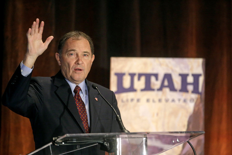 Photo - Utah Gov. Gary Herbert addresses the annual Outdoor Recreation Summit Thursday, May 8, 2014, in Salt Lake City. Gov. Herbert has kicked off his first annual Outdoor Recreation Summit by signing a long-awaited swap of state and federal lands in Grand, San Juan and Uintah Counties. The day's agenda includes discussions about public lands policy, business, recreation and tourism. (AP Photo/Rick Bowmer)