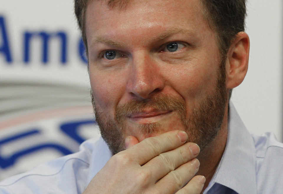 Photo -   Dale Earnhardt Jr pauses as he talks about missing the next two races with his second concussion in the past six weeks during a news conference prior to practice for Saturday's NASCAR Bank of America 500 NASCAR Sprint Cup series auto race in Concord, N.C., Thursday, Oct. 11, 2012. (AP Photo/Chuck Burton)