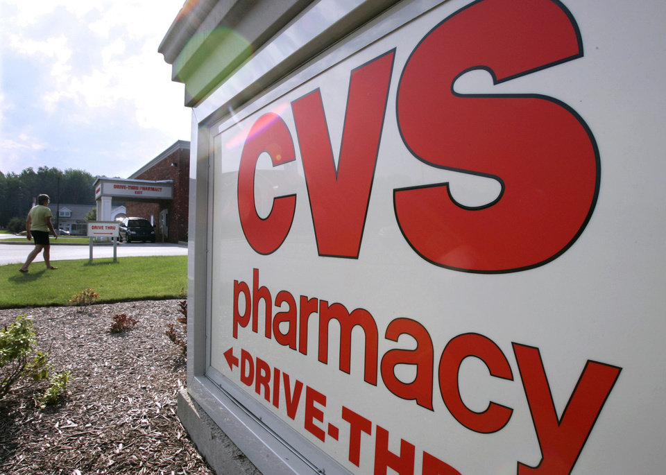 Customers take advantage of the drive-thru pharmacy window outside a CVS drugstore in a Bainbridge Township, Ohio. AP Photo