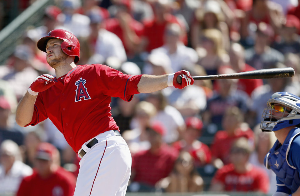 Photo - Los Angeles Angels' Chris Iannetta watches his three-run home run against the Kansas City Royals during the second inning of a spring training baseball game Friday, March 21, 2014, in Tempe, Ariz. (AP Photo/Ross D. Franklin)