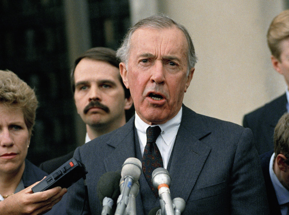 Photo - This 1989 file photo shows Iran-Contra special prosecutor Lawrence E. Walsh speaking to reporters outside U.S. District Court in Washington, D.C. AP PHOTO  Rick Bowmer