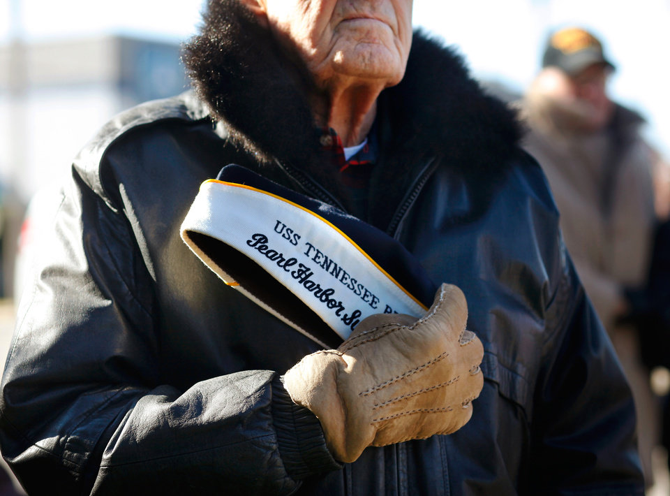 Photo - Art Gruber, 88, a survivor of the Japanese attack on Pearl Harbor in 1941,  attended  the memorial service at NW 13 and Broadway in Oklahoma City, Wednesday, December 7, 2011.  Gruber, of Norman, was aboard the USS Tennessee when US Naval forces were attacked.  In this photo, he stands and presses his cap against his chest during the playing of the national anthem at the beginning of the ceremony. He said his ship was the closest one anchored to the USS Arizona. Gruber said the USS Tennessee was the only ship on battleship row that did not sink.  He was 18 at the time of the attack. The memorial service was held  in front of the anchor rsalvaged  from the USS Oklahoma after it sank. . Photo by Jim Beckel, The Oklahoman