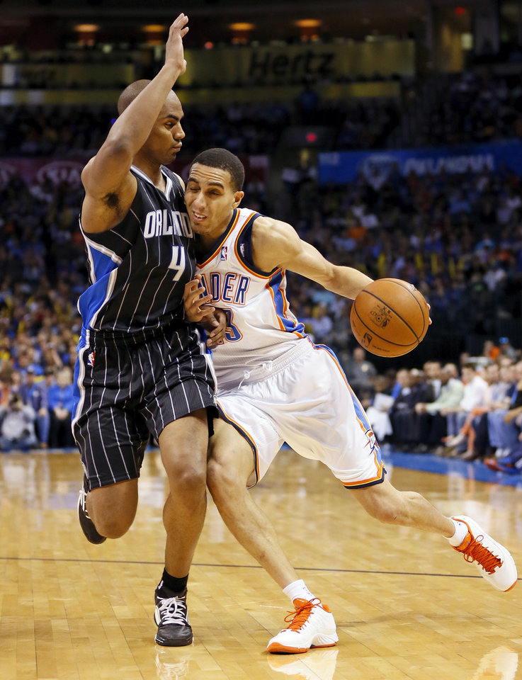 Oklahoma City's Kevin Martin (23) drives against Orlando's Arron Afflalo (4) during an NBA basketball game between the Oklahoma City Thunder and the Orlando Magic at Chesapeake Energy Arena in Oklahoma City, Friday, March 15, 2013. Photo by Nate Billings, The Oklahoman