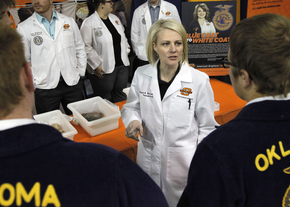 Photo -  Kayse Shrum, President of the OSU Health Sciences Center, speaks to students at the April 29 FFA event at the Cox Convention Center, about going into medicine. Photo by Paul Hellstern, The Oklahoman   PAUL HELLSTERN -  Oklahoman