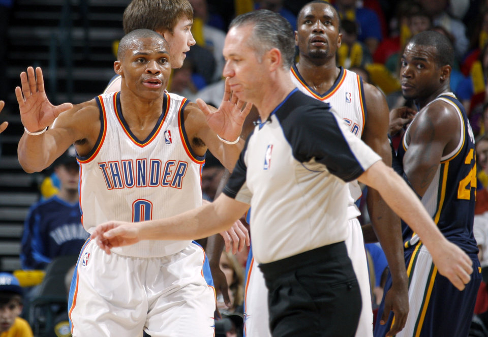 Photo - Oklahoma City's Russell Westbrook (0) reacts towards official Jason Phillips during an NBA game between the Oklahoma City Thunder and the Utah Jazz at Chesapeake Energy Arena in Oklahoma CIty, Tuesday, Feb. 14, 2012. Photo by Bryan Terry, The Oklahoman
