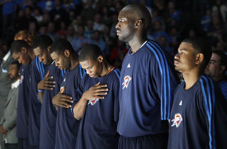 From left, John Lucas III, Kevin Durant, Jeff Green, Russell Westbrook, Johan Petro and Earl Watson of the Thunder stand for the National Anthem before the NBA basketball game between the Oklahoma City Thunder and the Milwaukee Bucks at the Ford Center in Oklahoma City, Wednesday, Oct. 29, 2008. This was the regular season debut of the Thunder. BY NATE BILLINGS, THE OKLAHOMAN