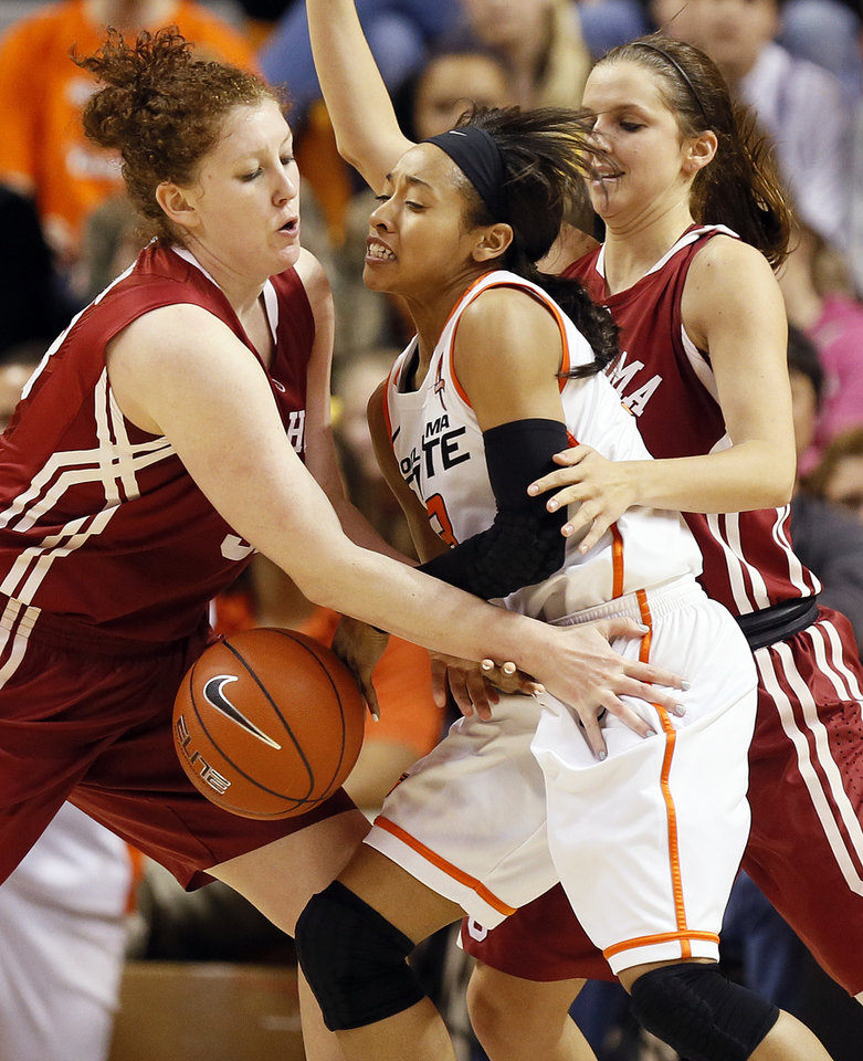 Photo - Oklahoma State's Tiffany Bias (3) loses the ball as she is caught between Oklahoma's Joanna McFarland (53), left, and Morgan Hook (10) during the Bedlam women's college basketball game between Oklahoma State University and the University of Oklahoma at Gallagher-Iba Arena in Stillwater, Okla., Saturday, Feb. 23, 2013. OSU beat OU, 83-62. Photo by Nate Billings, The Oklahoman