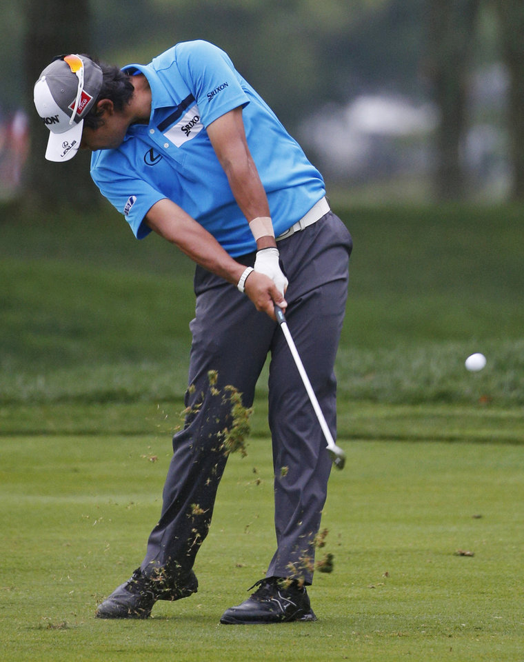 Photo - Hideki Matsuyama, of Japan, hits from the fairway on the first hole during the final round of the PGA Championship golf tournament at Valhalla Golf Club on Sunday, Aug. 10, 2014, in Louisville, Ky. (AP Photo/Mike Groll)