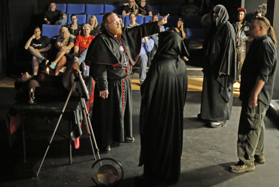 "Photo - Satanist Adam Daniels shares information about the history of the ""black mass"" and Satanism during his black mass event at the Civic Center Music Hall on Sunday.   Online: Find more photos from the event online at  NewsOK. com. Photo by  Doug Hoke,  The Oklahoman  DOUG HOKE - THE OKLAHOMAN"