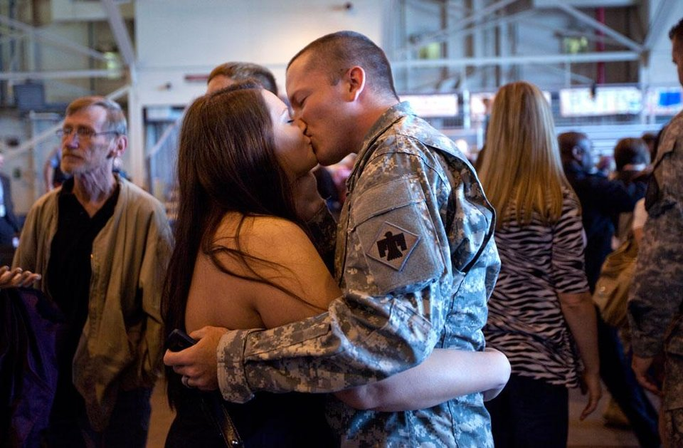 Spc. Thomas Chastain kisses his wife, Stephanie of Midwest City during a homecoming ceremony for members of the Oklahoma National Guard\'s 45th Infantry Brigade Combat Team returning from Afghanistan and Kuwait at the Will Rogers Air National Guard Base in Oklahoma City, Thursday, April 5, 2012. Photo by Sarah Phipps, The Oklahoman