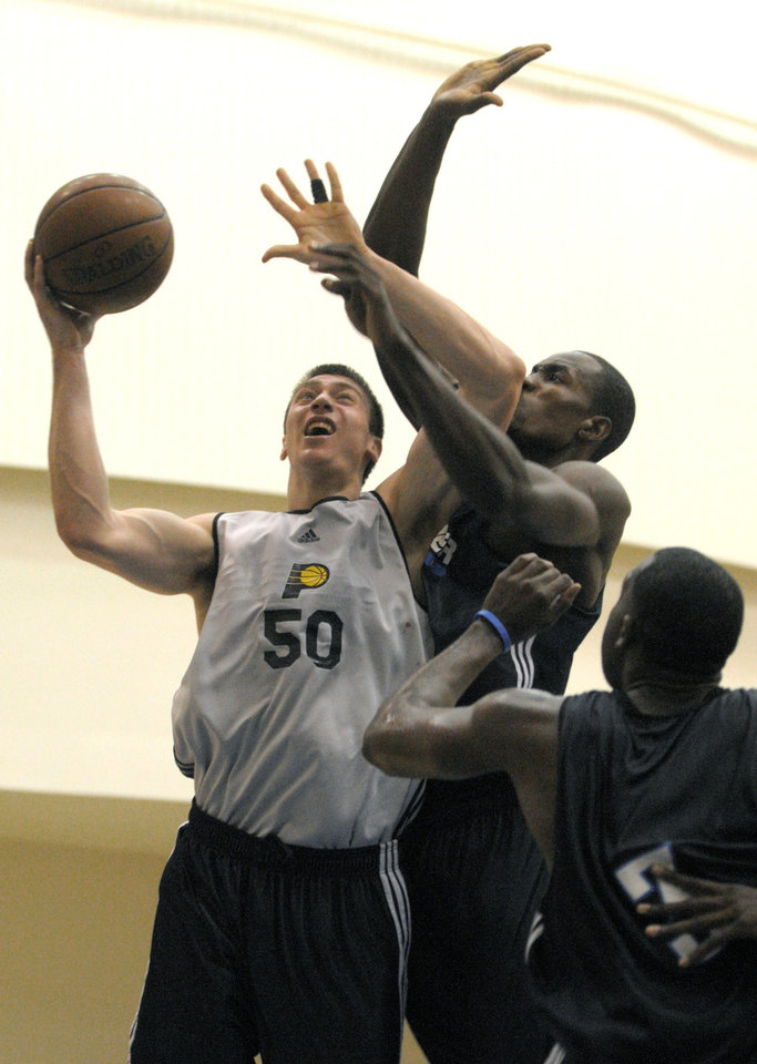 Serge Ibaka, center, has made 12 of 15 shot attempts in his first two summer league games with the Thunder. AP PHOTO