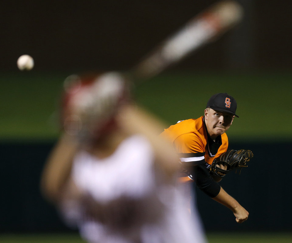 Photo - Oklahoma State's Tyler Buffett pitches during an NCAA college baseball game against Oklahoma in the Big 12 baseball tournament at the Chickasaw Bricktown Ballpark in Oklahoma City, Friday, May 23, 2014. (AP Photo/The Oklahoman, Nate Billings)