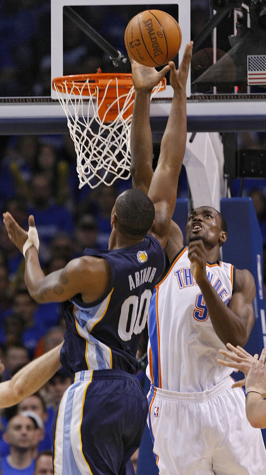 Photo - Oklahoma City's Serge Ibaka (9) blocks the shot of Memphis' Darrell Arthur (00) during game one of the Western Conference semifinals between the Memphis Grizzlies and the Oklahoma City Thunder in the NBA basketball playoffs at Oklahoma City Arena in Oklahoma City, Sunday, May 1, 2011. Photo by Chris Landsberger, The Oklahoman
