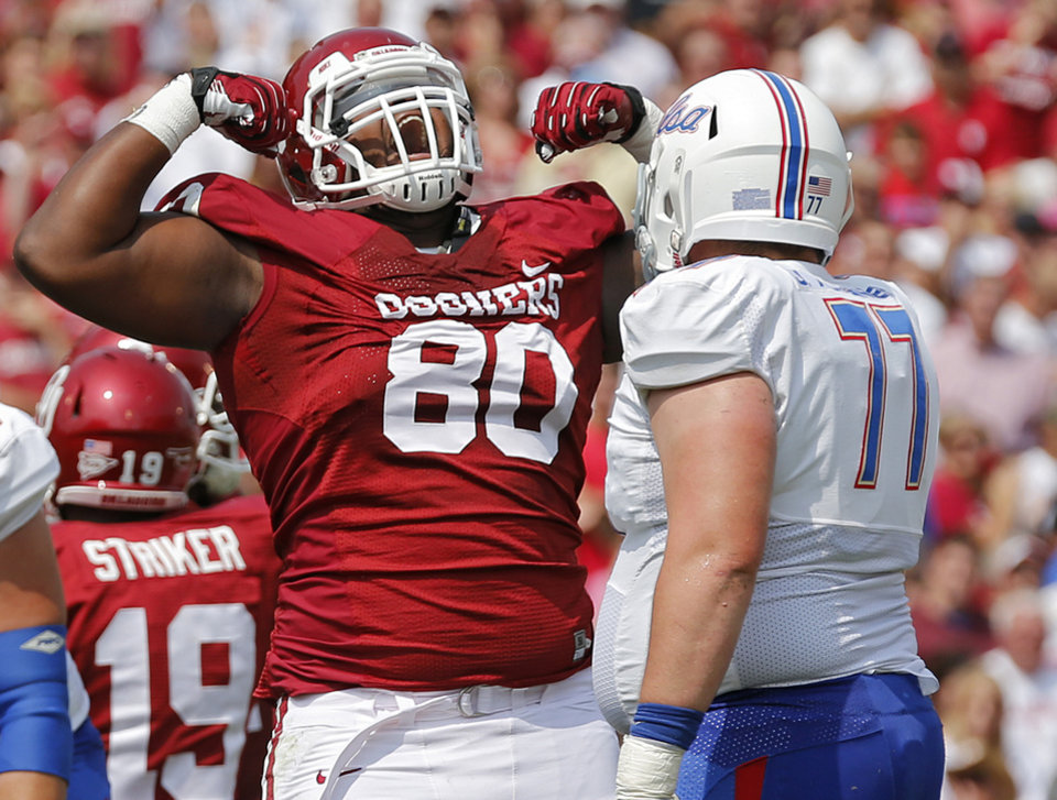 Oklahoma's Jordan Phillips (80) reacts to a stop in front of Tulsa 's Jake Alexander (77) during the college football game between the University of Oklahoma Sooners (OU) and the University of Tulsa Hurricanes (TU) at the Gaylord-Family Oklahoma Memorial Stadium on Saturday, Sept. 14, 2013 in Norman, Okla.  Photo by Chris Landsberger, The Oklahoman