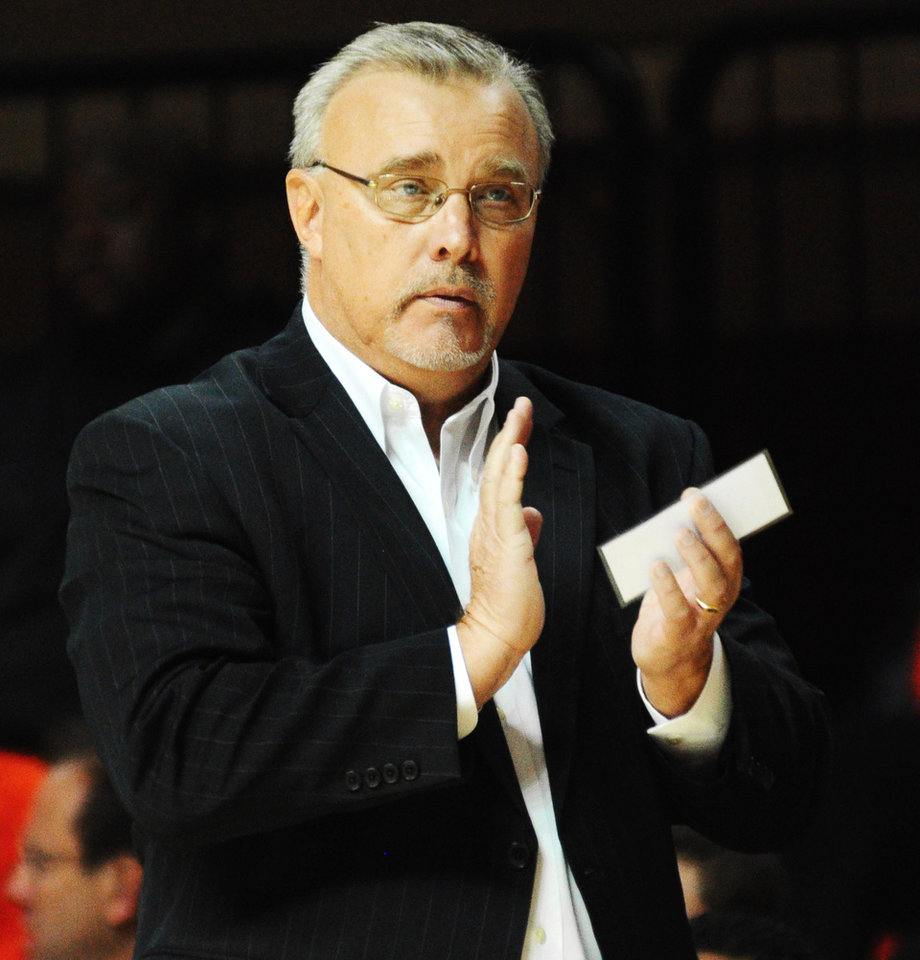 Oklahoma State coach Jim Littell claps after a made basket during the Oklahoma State womens\' basketball game versus Southern California on Nov. 22, 2013 at Gallagher Iba Arena in Stillwater, Okla. Photo by KT King/For the Oklahoman