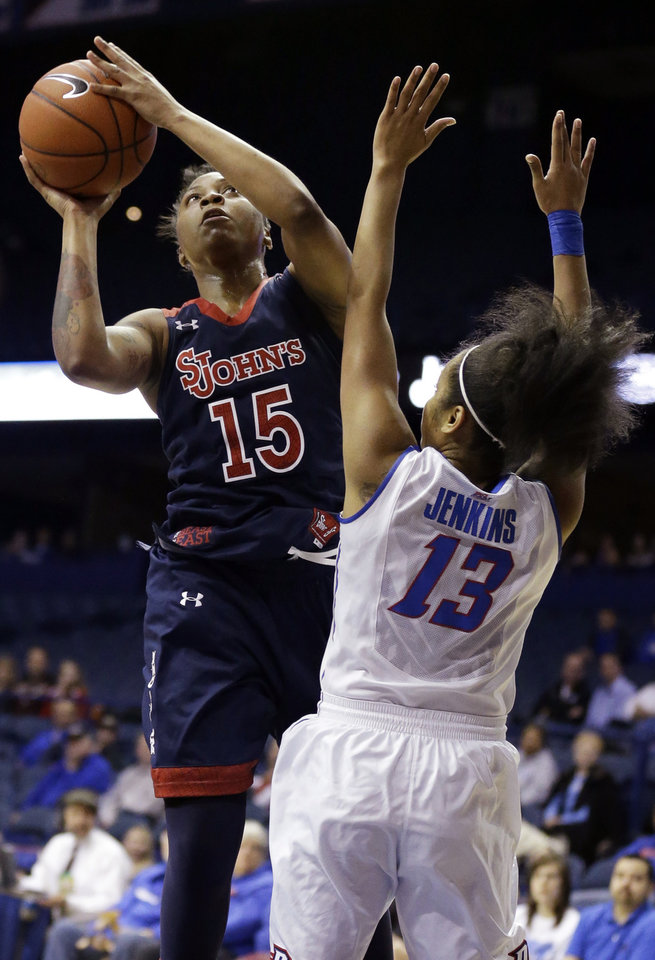 Photo - St. John's guard Danaejah Grant, left, shoots against DePaul defender Chanise Jenkins during the first half of an NCAA college basketball game in the final of the 2014 Big East women's basketball tournament in Rosemont, Ill., Tuesday, March 11, 2014. (AP Photo/Nam Y. Huh)