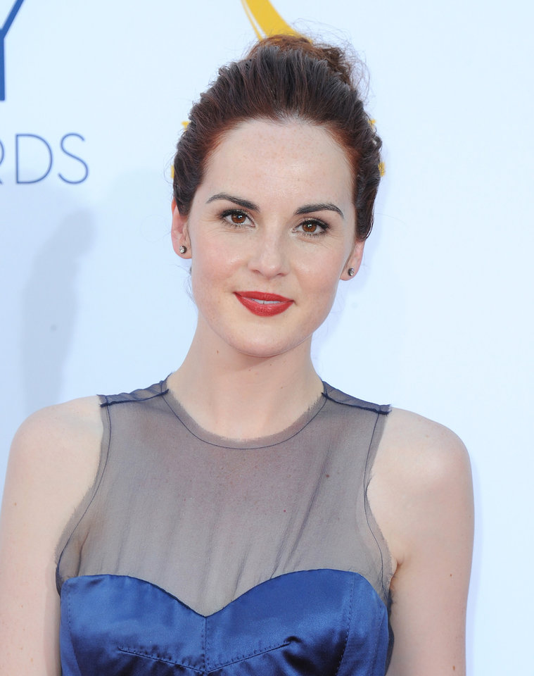 Actress Michelle Dockery arrives at the 64th Primetime Emmy Awards at the Nokia Theatre on Sunday, Sept. 23, 2012, in Los Angeles. (Photo by Jordan Strauss/Invision/AP)
