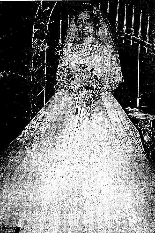 Photo - Most brides want their mother to approve the wedding dress they choose and Sally Chesnutt Felts was no exception. The taffeta and Chantilly lace dress Felts wore in 1957 has a touch of the Cinderella gown, which became popular again in the 1950s. Photo provided by Hope Forsyth.  Provided