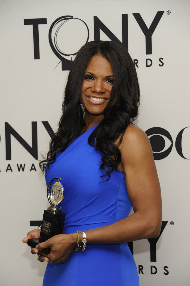 Photo -   Audra McDonald poses backstage with her award for best actress in a musical for her role in