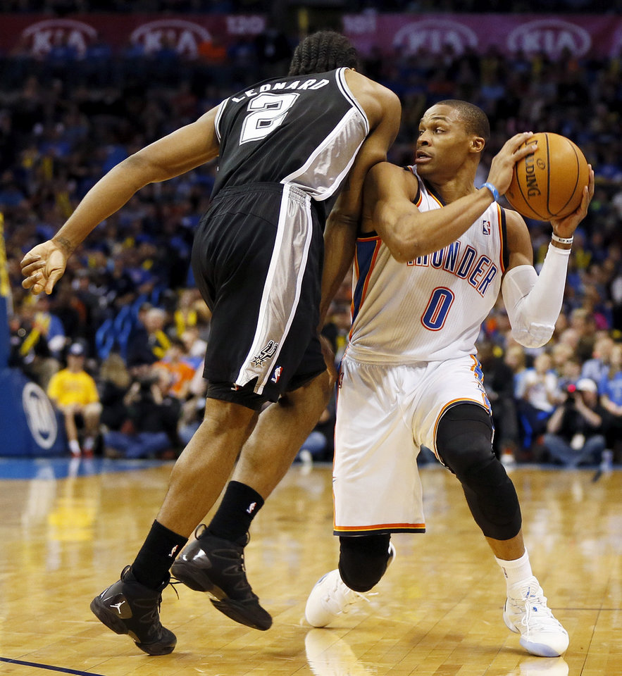 Oklahoma City's Russell Westbrook (0) collides with San Antonio's Kawhi Leonard (2) during an NBA basketball game between the Oklahoma City Thunder and the San Antonio Spurs at Chesapeake Energy Arena in Oklahoma City, Wednesday, Nov. 27, 2013. Photo by Nate Billings, The Oklahoman