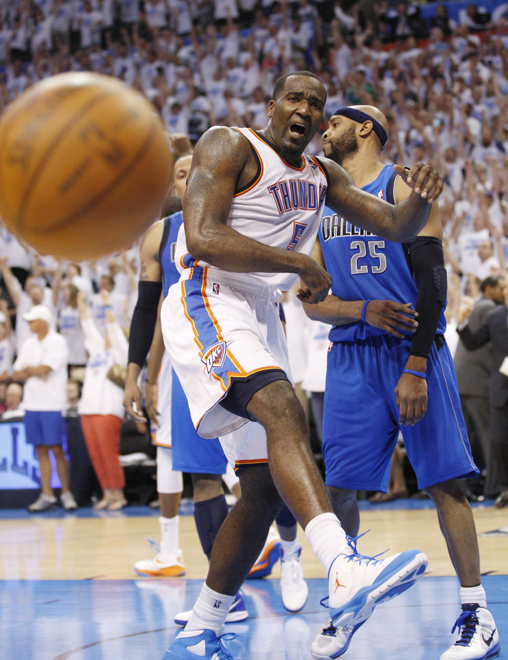 Photo -   Oklahoma City Thunder center Kendrick Perkins, left, and Dallas Mavericks guard Vince Carter (25) react at the end of Game 2 in the first round of the NBA basketball playoffs, in Oklahoma City, Monday, April 30, 2012. Oklahoma City won 102-99. (AP Photo/Sue Ogrocki)