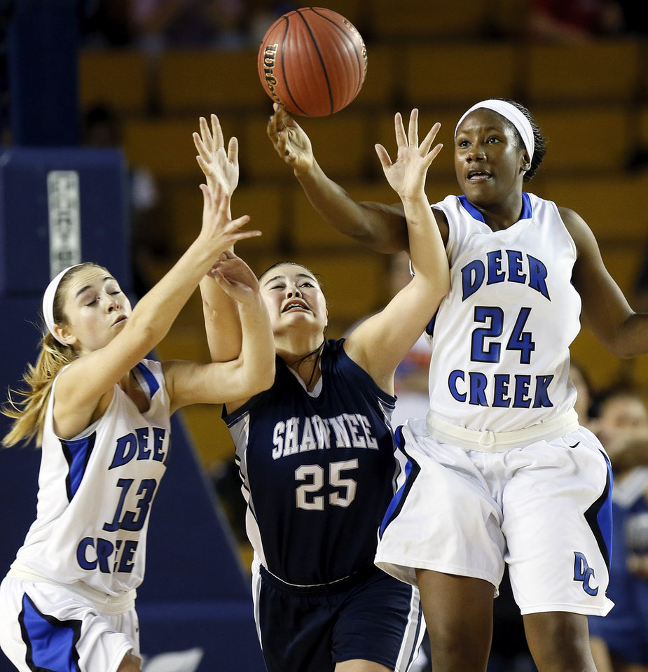 Photo - Shawnee's Micaela Yu (25) tries to grab the ball between Deer Creek's Whitney Jones (13) and Dakota Vann (24) during the Class 5A girls championship high school basketball game in the state tournament at the Mabee Center in Tulsa, Okla., Saturday, March 9, 2013. Yu fouled out of the game on this play. Deer Creek defeated Shawnee, 59-44. Photo by Nate Billings, The Oklahoman