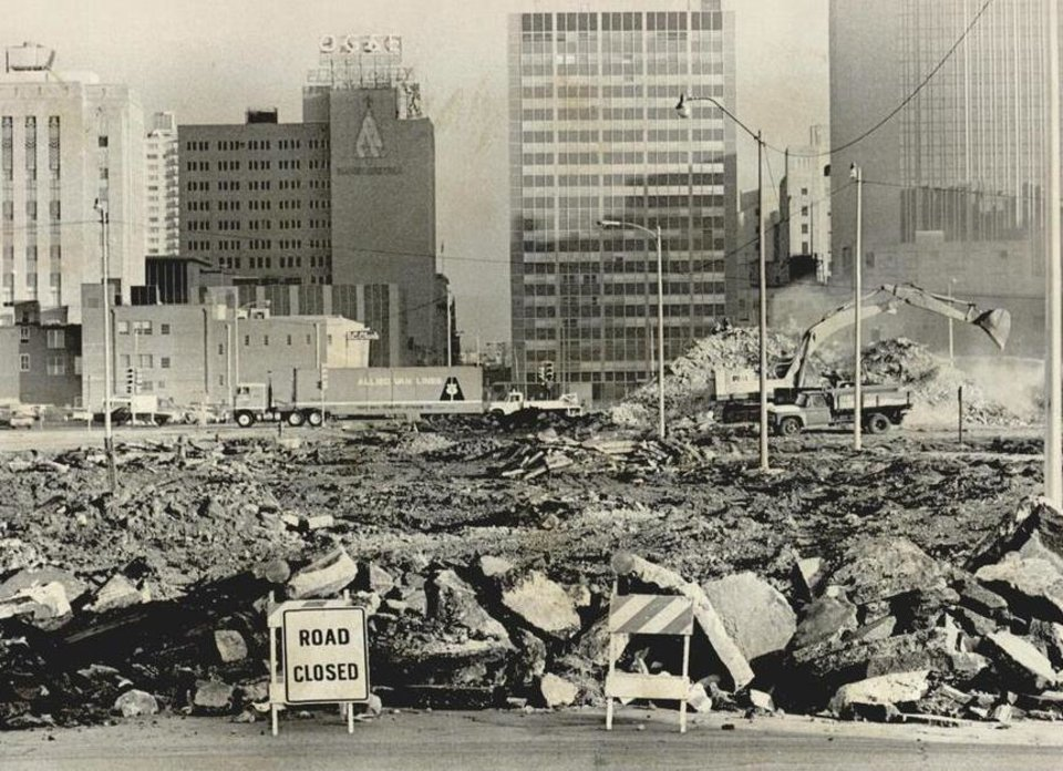 Photo - This 1978 photo shows mounds of debris and dirt where foundations and street pavement were being removed to make way for the Myriad Gardens project. [Photo by Roger Klock, The Oklahoman Archives]