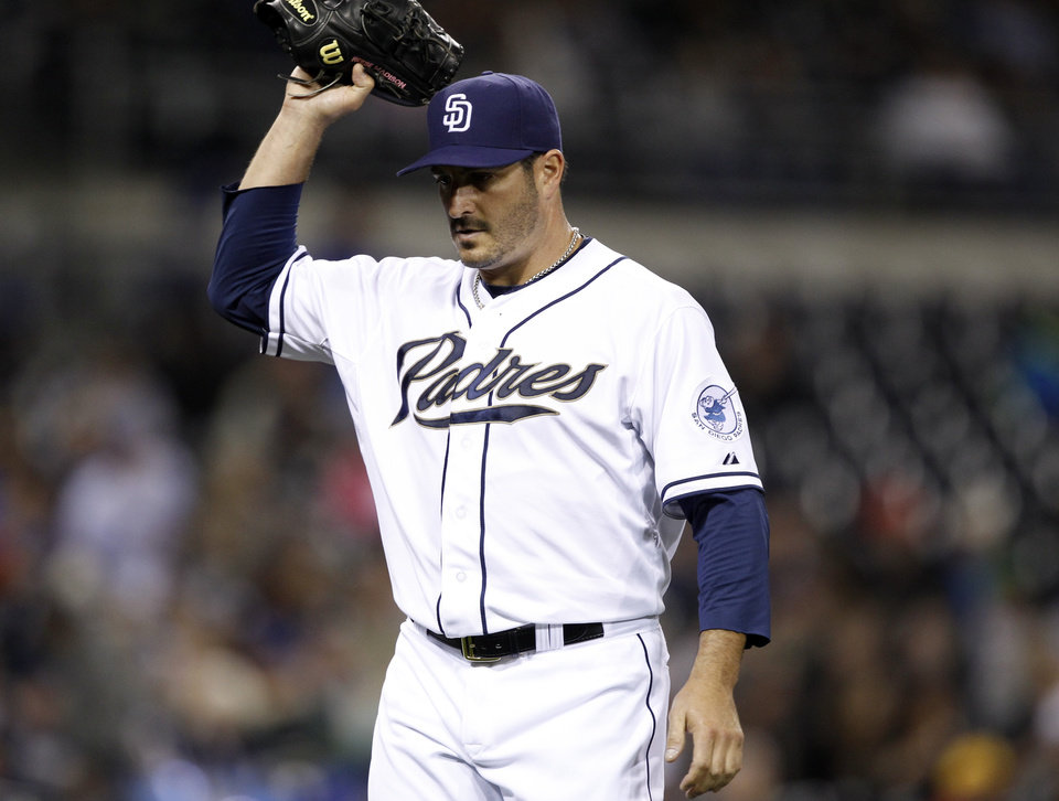 San Diego Padres starting pitcher Jason Marquis walks back to his dugout, then raises his glove after being pulled against the Milwaukee Brewers in the fifth inning during a baseball game Monday, April 22, 2013, in San Diego. (AP Photo/Alex Gallardo)