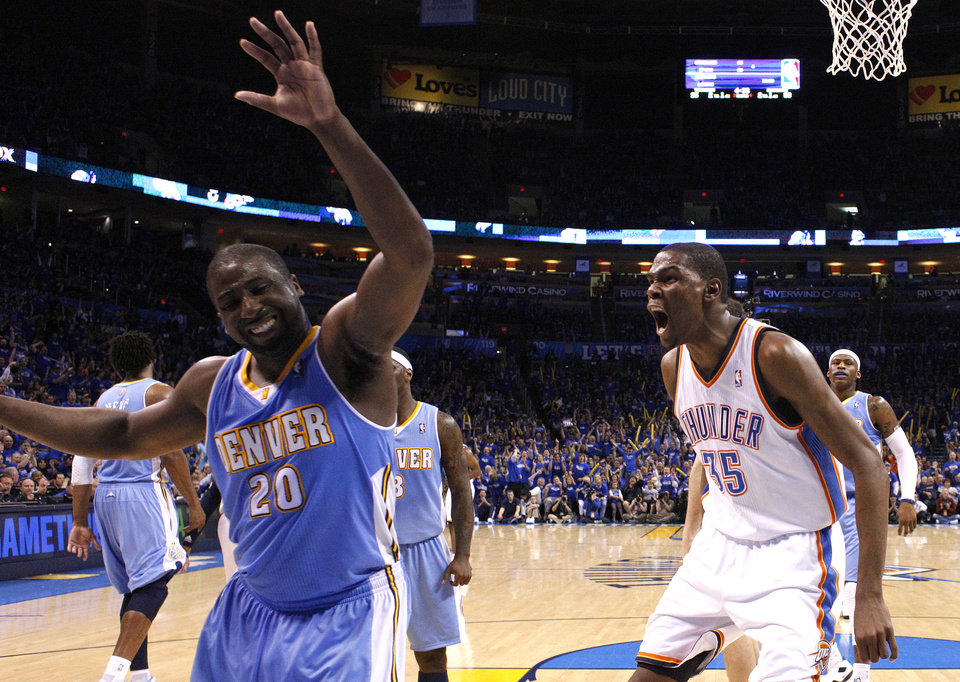 Oklahoma City\'s Kevin Durant (35) reacts after dunking the ball in front of Denver\'s Raymond Felton (20) during the first round NBA basketball playoff game between the Oklahoma City Thunder and the Denver Nuggets on Wednesday, April 20, 2011, at the Oklahoma City Arena. Photo by Sarah Phipps, The Oklahoman
