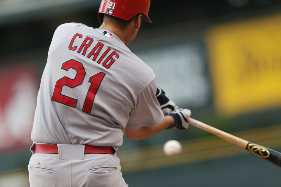 Photo - St. Louis Cardinals' Allen Craig strikes out while swinging at a pitch against the Colorado Rockies to end the top of the first inning of a baseball game in Denver on Monday, June 23, 2014. (AP Photo/David Zalubowski)