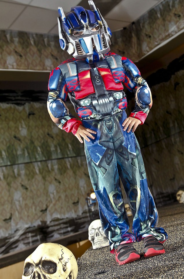 "Blake models a ""Transformers: Dark of the Moon"" costume sold at Party Galaxy. Photo by Chris Landsberger, The Oklahoman. <strong>CHRIS LANDSBERGER</strong>"