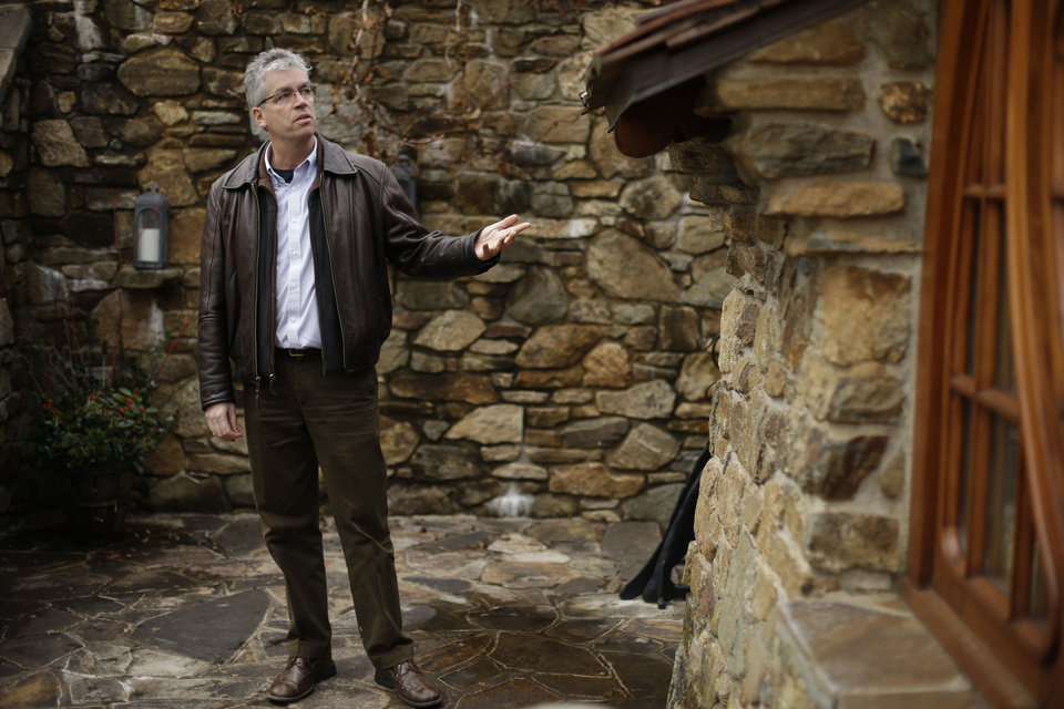 Architect Peter Archer speaks during an interview with the Associated Press at the �Hobbit House� Tuesday, Dec. 11, 2012, in Chester County, near Philadelphia. Archer has designed a �Hobbit House� containing a world-class collection of J.R.R. Tolkien manuscripts and memorabilia. AP photo