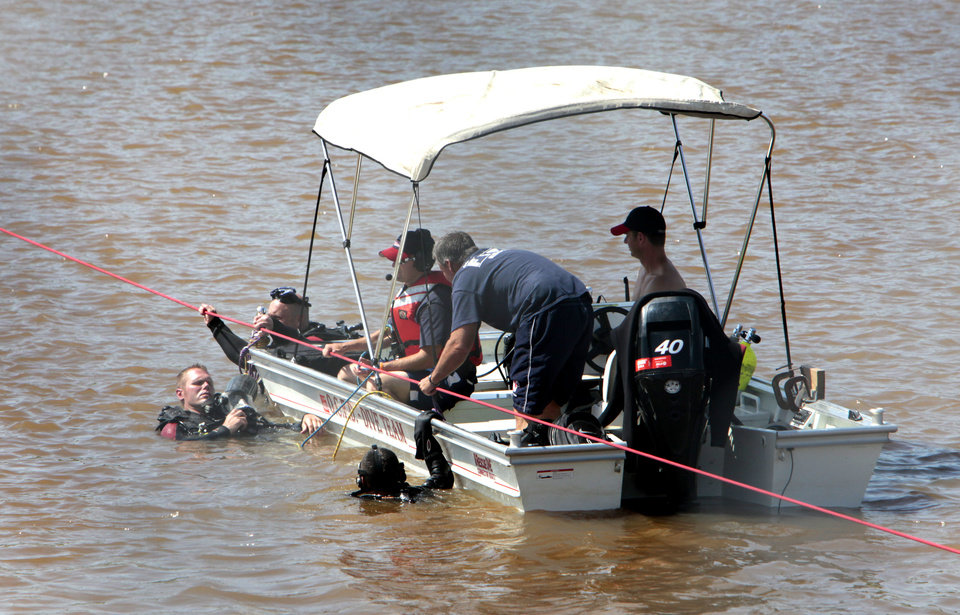 Oklahoma City Fire Department divers search for a victim of the May 31st storms in the Oklahoma River near May Avenue, Friday  , June 21, 2013. Photo by David McDaniel, The Oklahoman