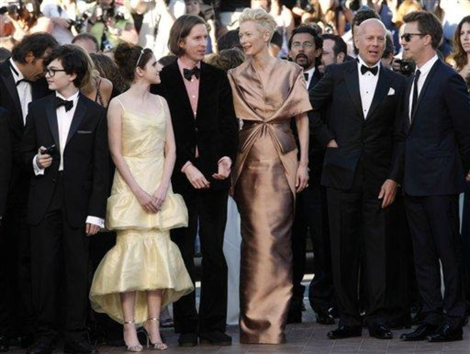 Photo - From left actors, Jared Gilman, Kara Hayward, director Wes Anderson, actors Tilda Swinton, Bruce Willis and Edward Norton arrive for the opening ceremony and screening of Moonrise Kingdom at the 65th international film festival, in Cannes, southern France, Wednesday, May 16, 2012. (AP Photo/Lionel Cironneau)