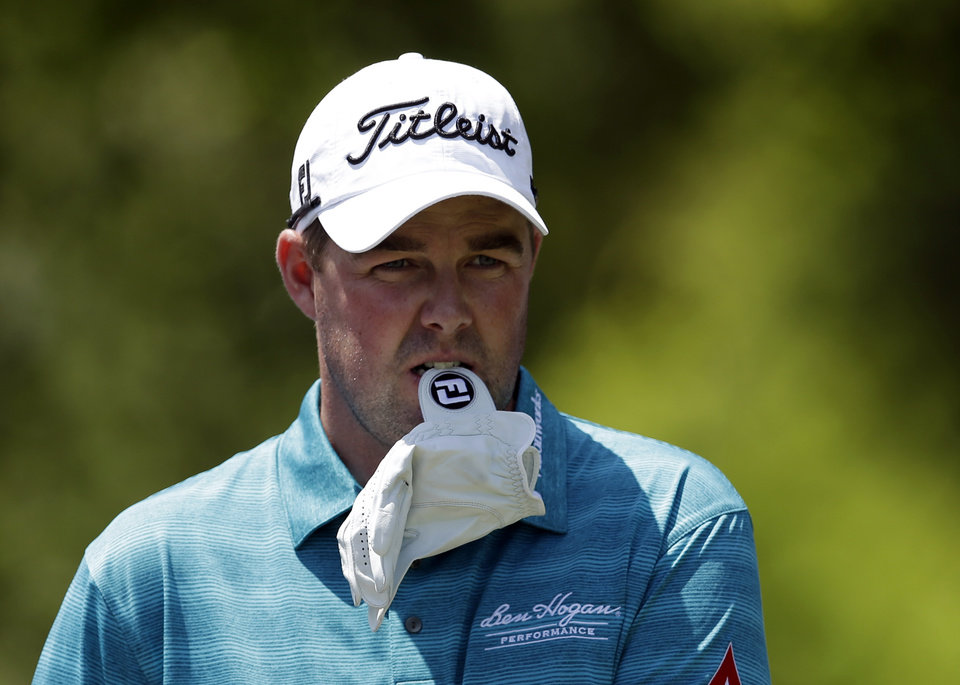 Photo - Marc Leishman of Australia prepares to hit off the first tee during the final round of the Byron Nelson Championship golf tournament, Sunday, May 18, 2014, in Irving, Texas. (AP Photo/Tony Gutierrez)
