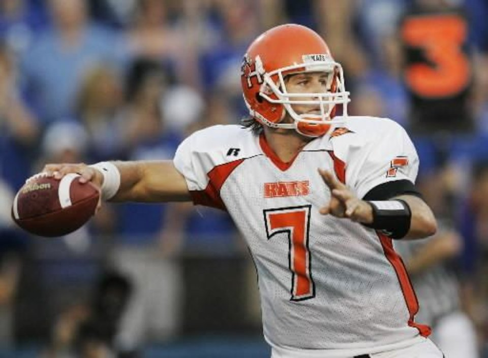 Photo - In this Sept. 20, 2008 file photo, Sam Houston State quarterback  Rhett  Bomar (7) passes down field during the first half of an NCAA college football game against Kansas in Lawrence, Kan. (AP Photo/Orlin Wagner, File)