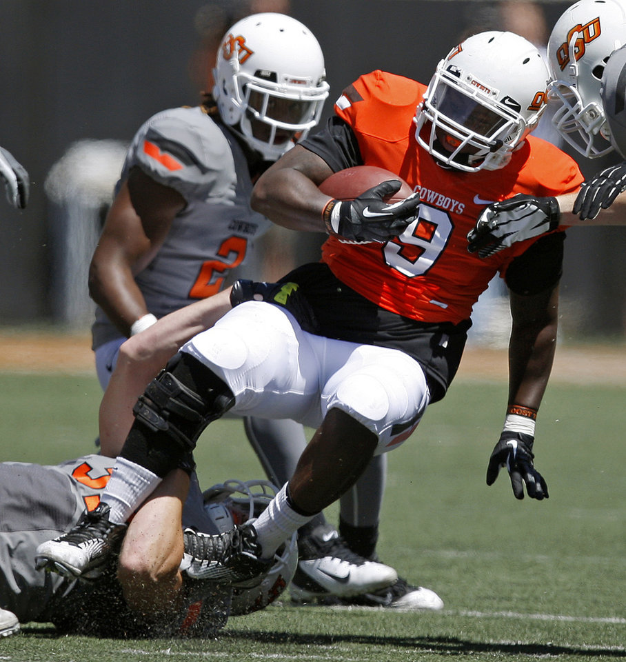 Photo - OSU's Kye Staley is brought down Alex Elkins as Lavocheya Cooper watches  during Oklahoma State's spring football game at Boone Pickens Stadium in Stillwater, Okla., Saturday, April 21, 2012. Photo by Bryan Terry, The Oklahoman
