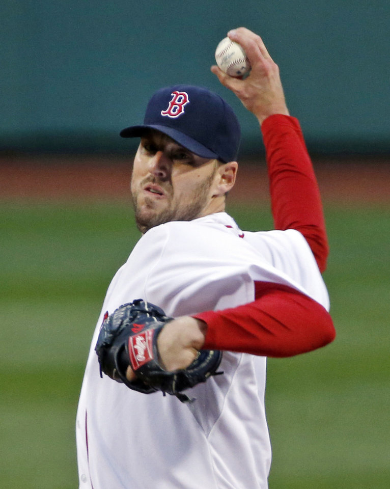 Photo - Boston Red Sox starting pitcher John Lackey delivers to the Atlanta Braves in the first inning of a baseball game at Fenway Park in Boston, Wednesday, May 28, 2014. (AP Photo/Elise Amendola)
