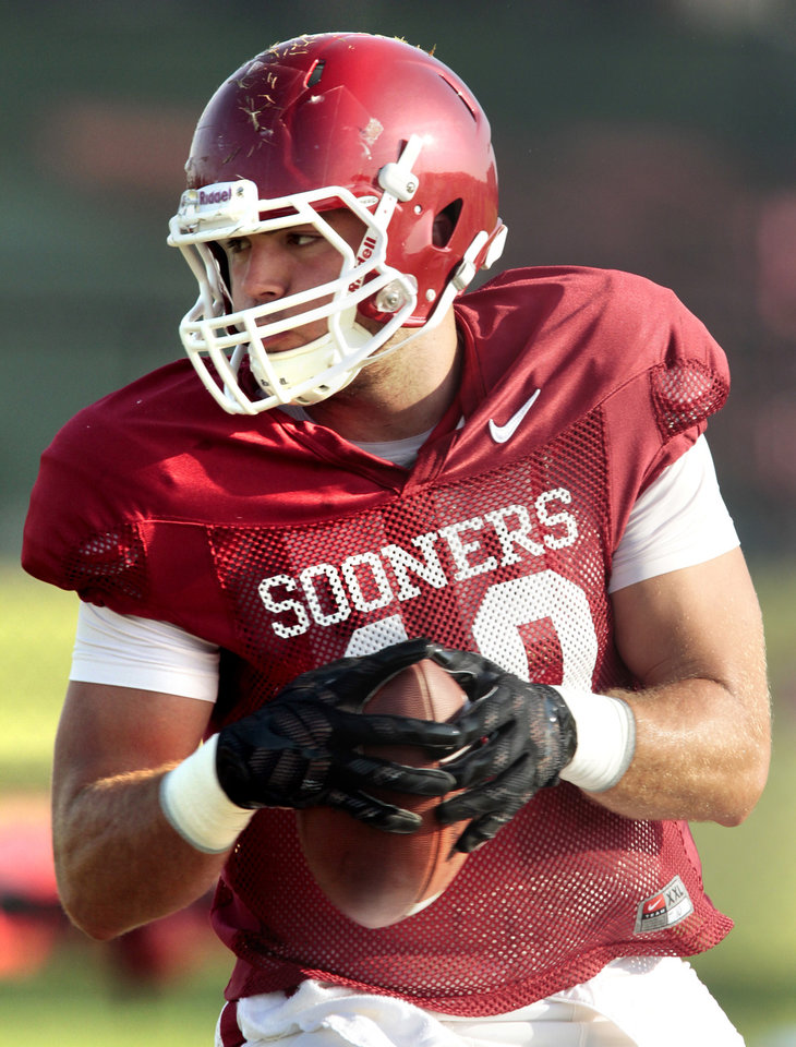 Photo - Tight end Blake Bell goes through drills during the University of Oklahoma Sooners (OU) football practice at the rugby fields in Norman, Okla., on Tuesday, Aug. 5, 2014. Photo by Steve Sisney, The Oklahoman